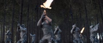 """The Capitol's Peacekeeper troops open fire with their bullpup guns in """"The Hunger Games: Mockingjay – Part 1″. Credit: Lionsgate"""